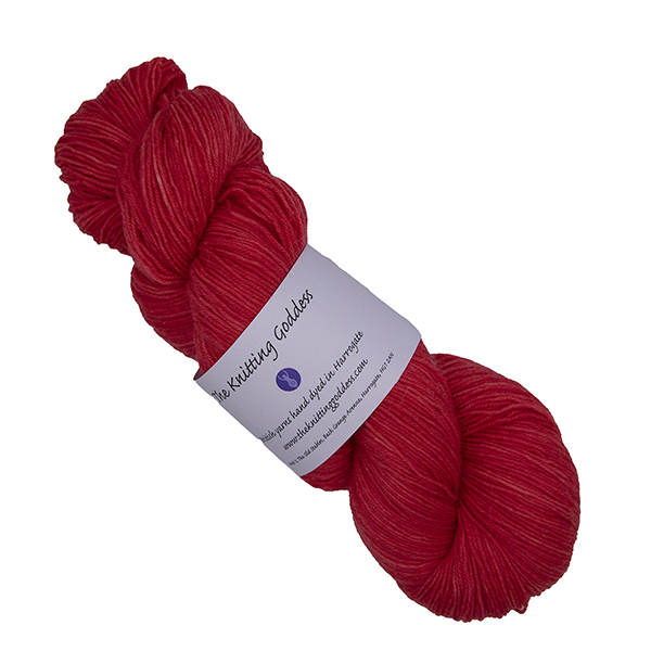 skein of red hand dyed yarn with The Knitting Goddess label