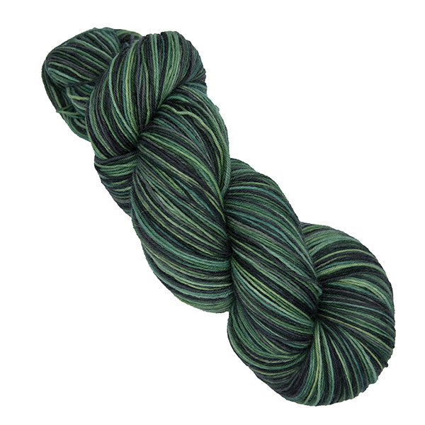 skein of hand dyed yarn in the moors colourway which is greens and greys