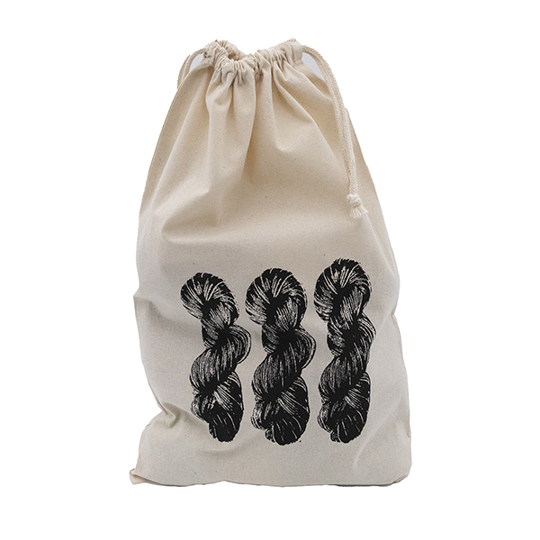 cream cotton drawstring bag with screen print design. Design is of three skeins of yarn and is printed in black. Drawstring on bag is closed